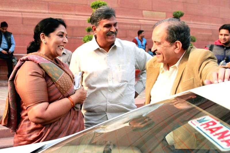 Congress MP Renuka Chowdhury with Union Rural Development Minister Chaudhary Birender Singh at the Parliament in New Delhi on Dec 10, 2015. - Chaudhary Birender Singh
