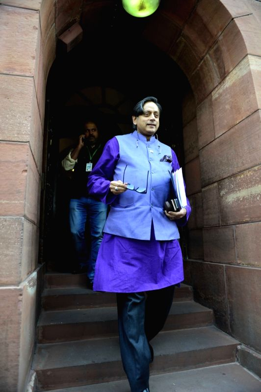 Congress MP Shashi Tharoor after the Day-1 of the winter session of the Parliament in New Delhi, on Nov 26, 2015. - Shashi Tharoor