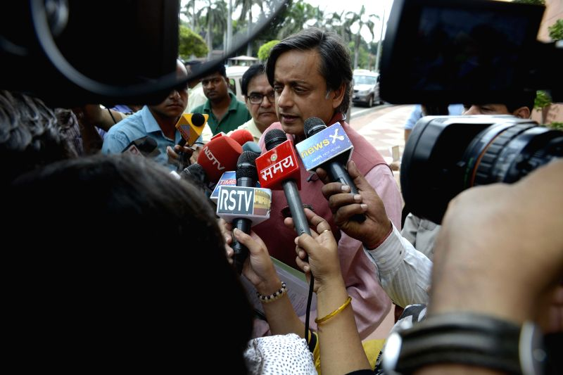 Congress MP Shashi Tharoor talks to press at the Parliament in New Delhi, on July 30, 2015.