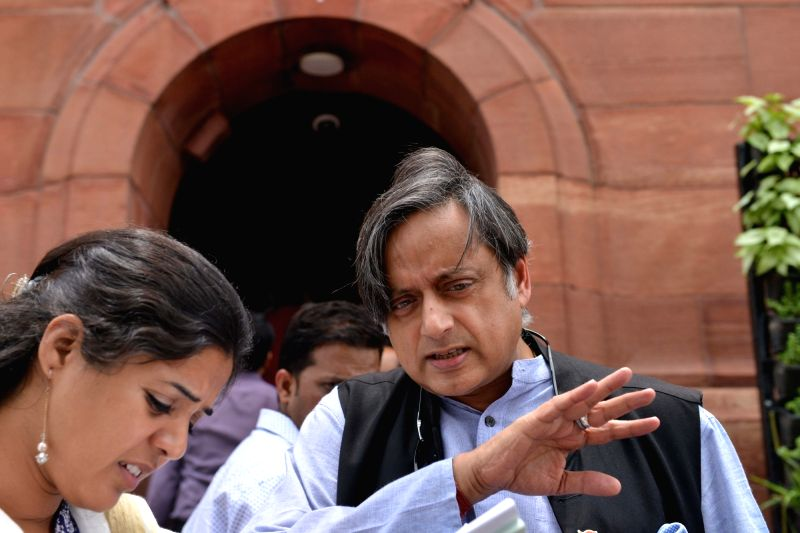 Congress MP Shashi Tharoor talks to the media at Parliament, in New Delhi on July 30, 2018. - Shashi Tharoor
