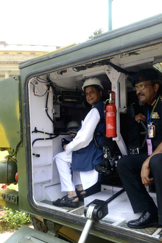 Congress MP Shashi Tharoor visits DRDO exhibition at Parliament in New Delhi on on Aug 5, 2016. - Shashi Tharoor