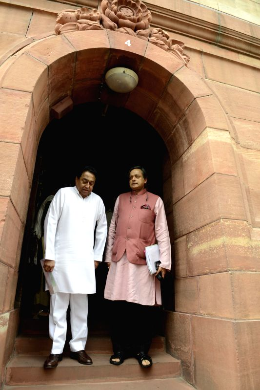 Congress MPs Shashi Tharoor and Kamal Nath at the Parliament in New Delhi, on July 30, 2015.