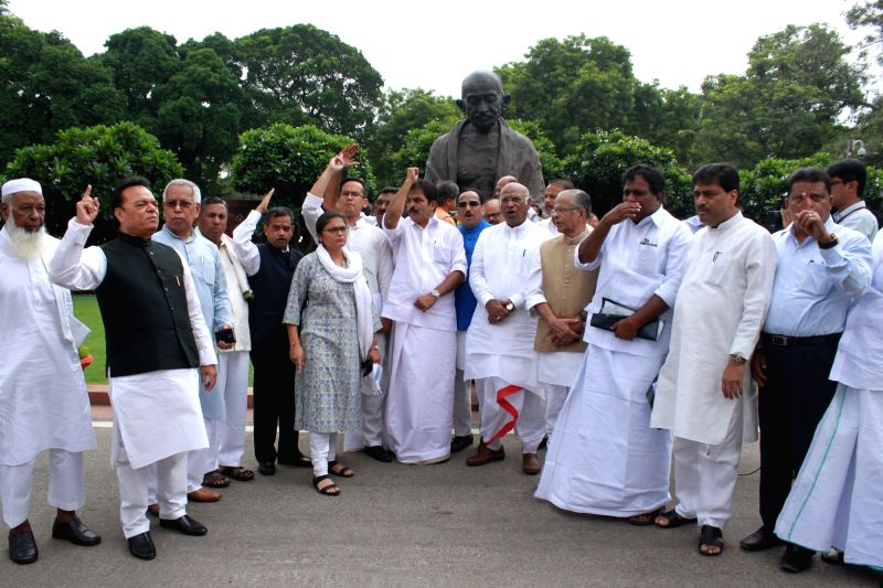 Congress MPs stage a demonstration against recent attacks on Dalits at Parliament in New Delhi, on Aug 9, 2016.