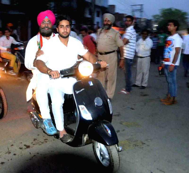 Congress Party candidate Partap Singh Bajwa during an election campaign on a motorbike in Batala, Punjab on April 26, 2014.