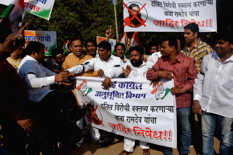 Congress Party workers protested to condemn Baba Ramdev`s derogatory statements against Rahul Gandhi, in Mumbai on April 26, 2014. - Rahul Gandhi