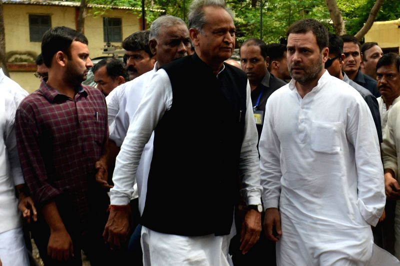 Congress President Rahul Gandhi accompanied by party leader Ashok Gehlot comes out of a Civil and Judicial Magistrates Court after appearing fro the hearing in a defamation case in ... - Rahul Gandhi