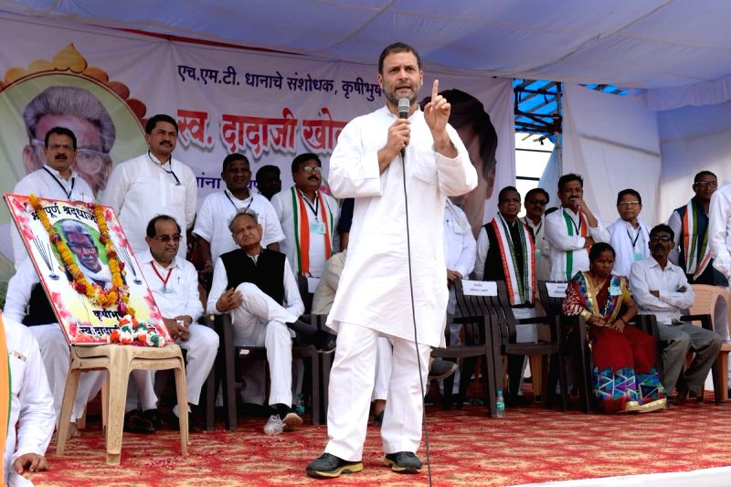 Congress President Rahul Gandhi addresses a party meeting, in Maharashtra's Nanded on June 13, 2018. Also seen Congress leader Ashok Gehlot. - Rahul Gandhi