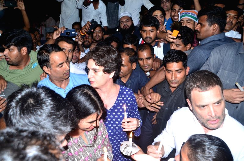 Congress President Rahul Gandhi and his sister Priyanka Gandhi participate in a candlelight vigil to protest incidents of rape in Unnao (Uttar Pradesh) and Kathua (Jammu and Kashmir) at ... - Rahul Gandhi and Priyanka Gandhi