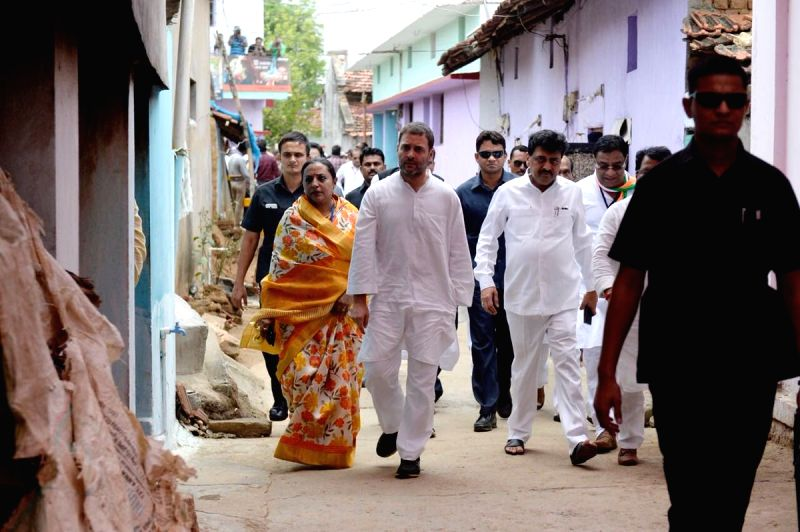 Congress President Rahul Gandhi arrives at the residence of rice innovator Late Dadaji Ramaji Khobragade, in Maharashtra's Nanded on June 13, 2018. - Rahul Gandhi