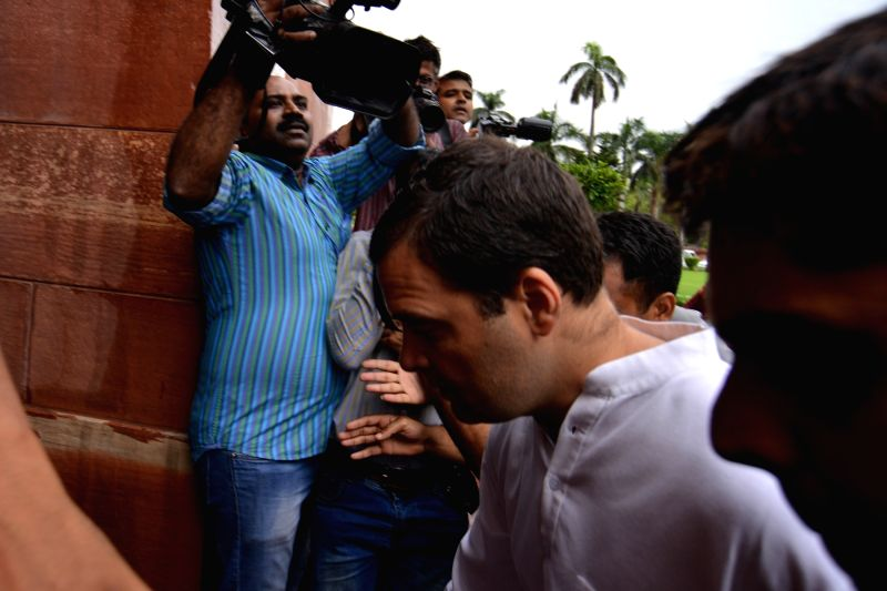 Congress President Rahul Gandhi at Parliament in New Delhi on July 20, 2018. He took everyone in the Lok Sabha by surprise when he went and hugged Prime Minister Narendra Modi after ... - Narendra Modi and Rahul Gandhi