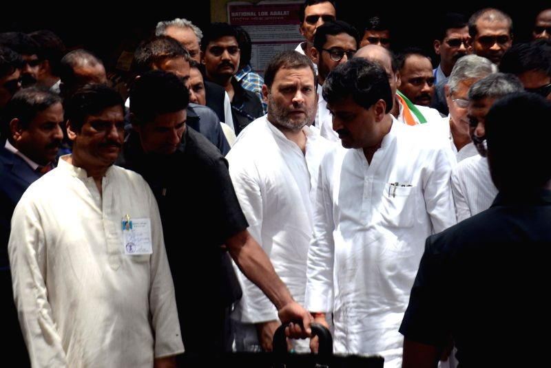 Congress President Rahul Gandhi comes out of a Civil and Judicial Magistrates Court after appearing for the hearing in a defamation case in Maharashtra's Bhiwandi on June 12, 2018. - Rahul Gandhi