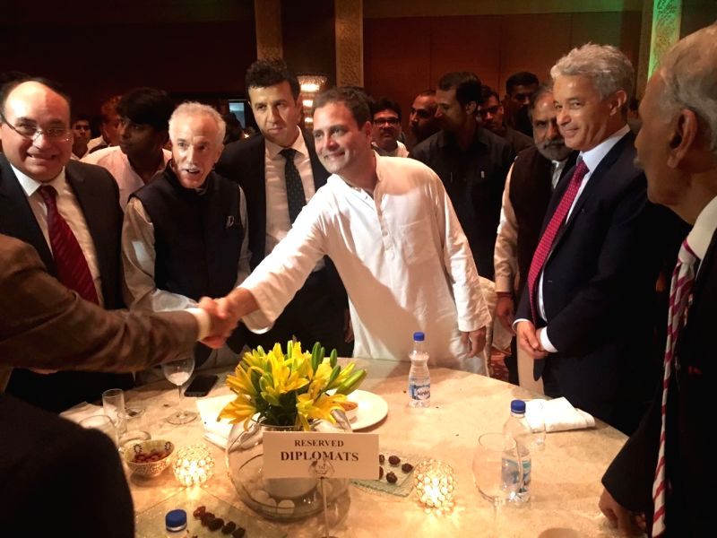 Congress President Rahul Gandhi greets guests at an iftaar party hosted by him in New Delhi on June 13, 2018. - Rahul Gandhi