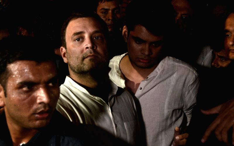 Congress President Rahul Gandhi leads a candlelight vigil to protest incidents of rape in Unnao (Uttar Pradesh) and Kathua (Jammu and Kashmir) at India Gate in New Delhi on April 12, 2018. - Rahul Gandhi