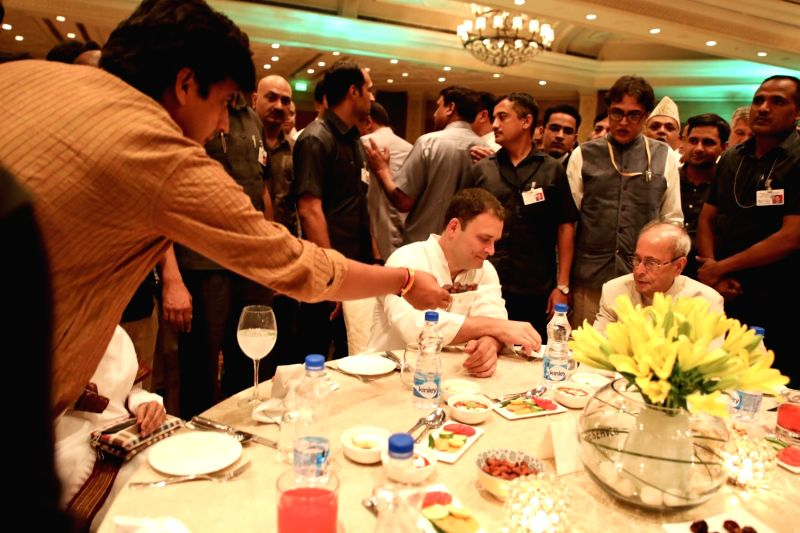 Congress President Rahul Gandhi with Former President Pranab Mukherjee at an iftaar party hosted by him in New Delhi on June 13, 2018. - Rahul Gandhi and Pranab Mukherjee