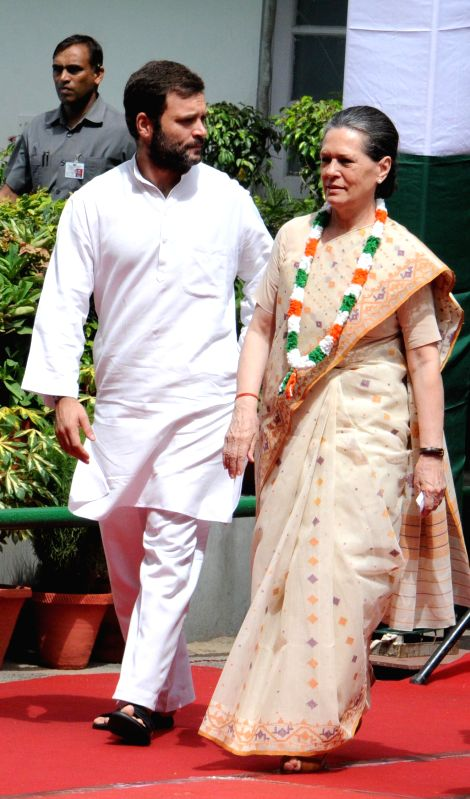 Congress president Sonia Gandhi and Congress Vice President Rahul Gandhi during 68th Independence Day celebrations at Congress Headquarters in New Delhi on Aug 15, 2014. - Sonia Gandhi and Rahul Gandhi