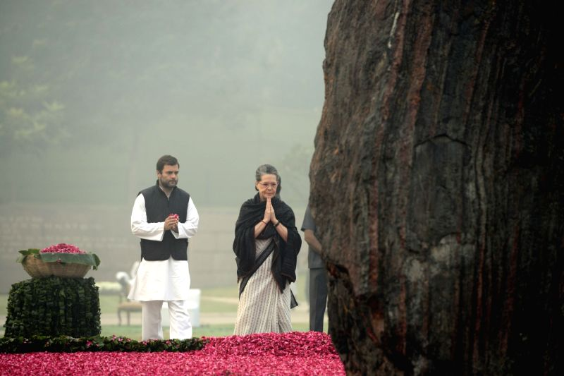 Congress president Sonia Gandhi and Congress vice president Rahul Gandhi paying homage at the samadhi of former Prime Minister Indira Gandhi to commemorate her 31st death anniversary at ... - Sonia Gandhi and Rahul Gandhi
