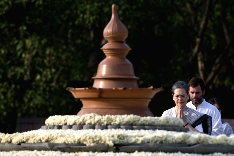 Congress president Sonia Gandhi and Congress vice president Rahul Gandhi paying homage to former Prime Minister Rajiv Gandhi on the occasion of his 25th Death Anniversary at Vir Bhumi in ... - Rajiv Gandhi, Sonia Gandhi and Rahul Gandhi