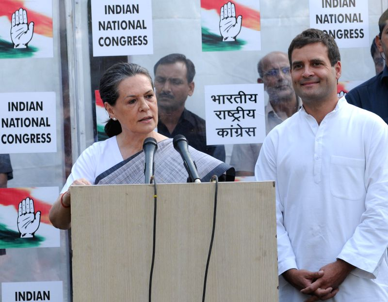 Congress president Sonia Gandhi and party vice president Rahul Gandhi during a press conference at  AICC Office in New Delhi on May 16, 2014. - Sonia Gandhi and Rahul Gandhi