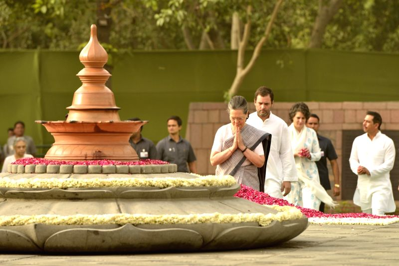 Congress President Sonia Gandhi, pays tribute to her husband, former prime minister Rajiv Gandhi on his death anniversary at Vir Bhoomi in New Delhi on May 21, 2017. - Rajiv Gandhi and Sonia Gandhi