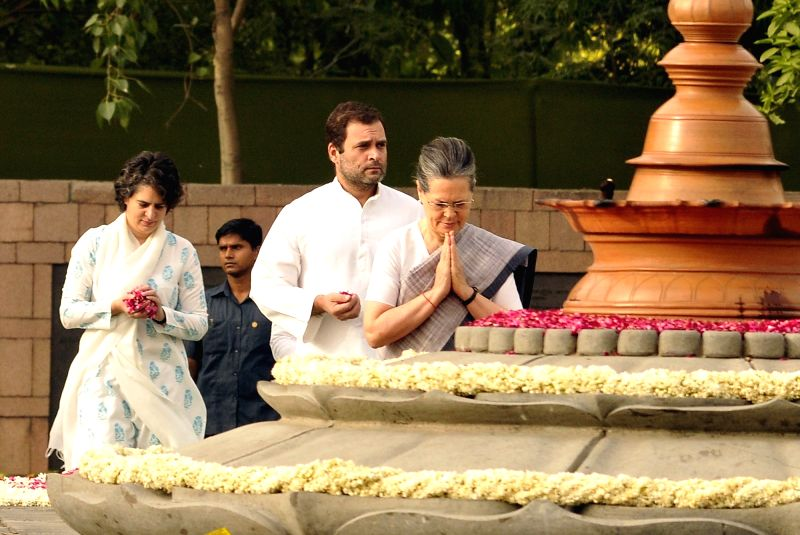 Congress President Sonia Gandhi, pays tribute to her husband, former prime minister Rajiv Gandhi on his death anniversary at Vir Bhoomi in New Delhi on May 21, 2017. Also seen Congress ... - Rajiv Gandhi, Sonia Gandhi, Rahul Gandhi and Priyanka Gandhi
