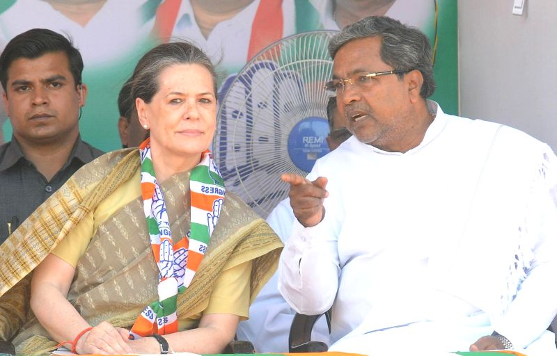 Congress president Sonia Gandhi with Karnataka Chief Minister Siddaramaiah during an Election Campaign in Mysore on April 9, 2014. - Siddaramaiah