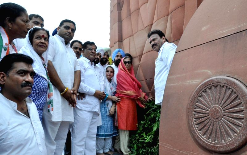 Congress secretary in-charge of Punjab Asha Kumari pays obeisance at the Jallianwala Bagh in Amritsar on July 22, 2016.