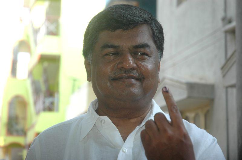 :Congress Senior er BK Hariprasad  cast his vote   during the Karnataka Assembly election, in Bangalore on May 5, 2013. (Photo: IANS).