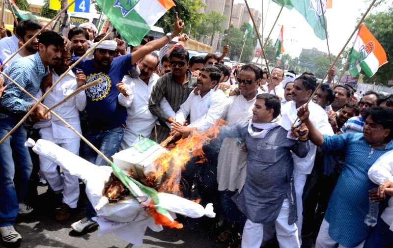 Congress supporters protesting the proposed hike in railway fares in front of Vidhan Sabha in Lucknow on June 21, 2014.
