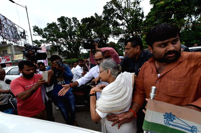 Congress' Uttar Pradesh chief ministerial candidate Sheila Dikshit who got injured during a roadshow being taken away in Lucknow on July 17, 2016. - Sheila Dikshit