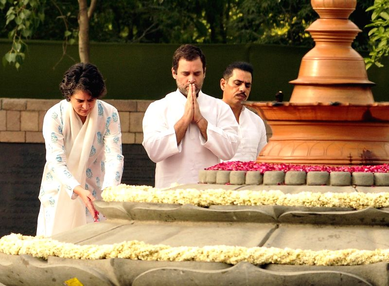 Congress vice president Rahul Gandhi along with his sister Priyanka Gandhi, pays tribute to their father, former prime minister Rajiv Gandhi on his death anniversary at Vir Bhoomi in New ... - Rajiv Gandhi, Rahul Gandhi and Priyanka Gandhi