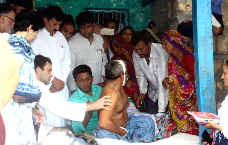 Congress vice president Rahul Gandhi meets the parents of Una's village victims at Samdhiyala village in Gujarat on July 21, 2016. - Rahul Gandhi