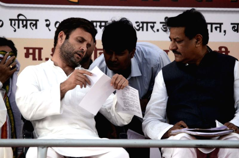 Congress vice president Rahul Gandhi with Maharashtra Chief Minister Prithviraj Chavan during a rally in Mumbai on April 20, 2014. - Prithviraj Chavan