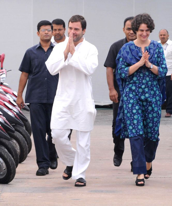 Congress vice president Rahul Gandhi with his sister Priyanka Gandhi Vadra distributes keys of three-wheeler scooters to physically handicapped people during a charity event in New Delhi on August ...