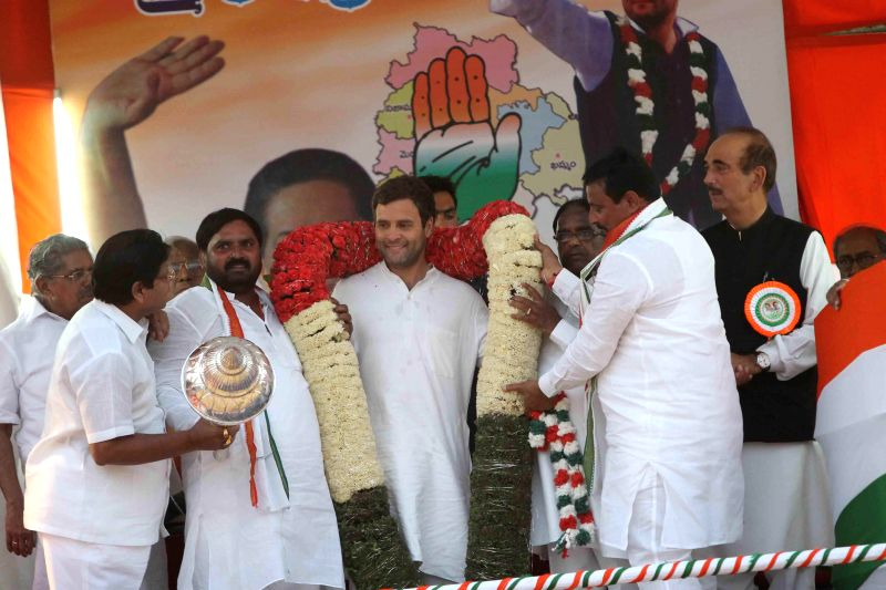 Congress vice president Rahul Gandhi with party leader Ghulam Nabi Azad and others during a rally in Hyderabad on April 25, 2014.