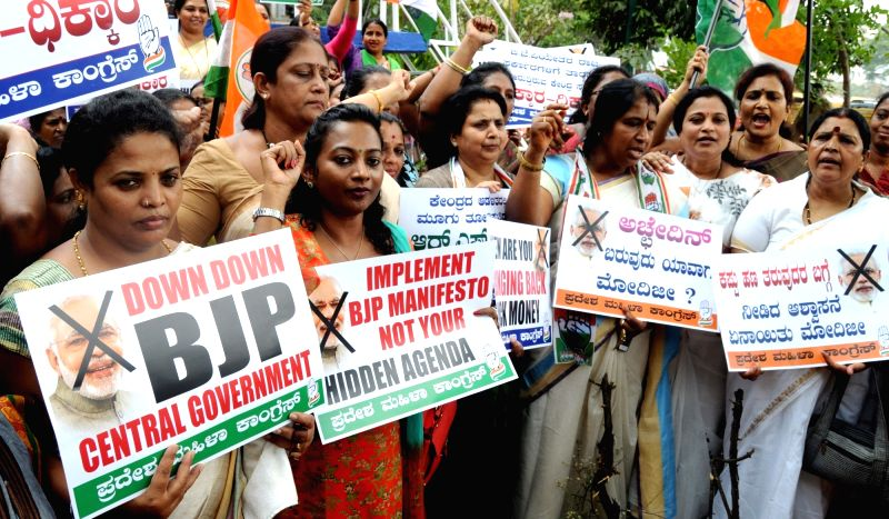 Congress women wing stage a demonstration against the Central Government in Bengaluru on April 6, 2016.