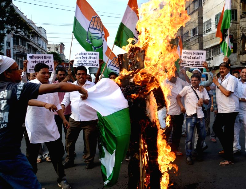 "Congress workers burn an effigy of Pakistan Prime Minister Nawaz Sharif during a demonstration after an Army soldier and a BSF trooper were killed and ""mutilated"" on the LoC in ... - Nawaz Sharif"