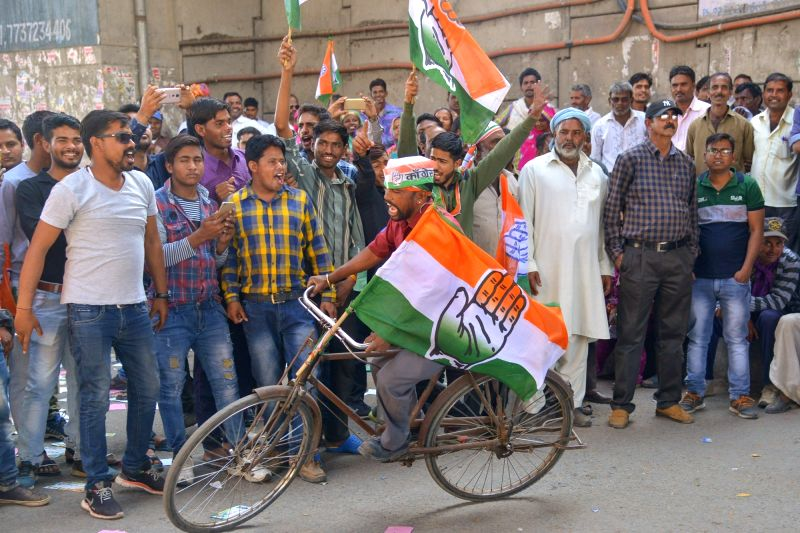 Congress workers celebrate after the party raced ahead of the BJP in the Lok Sabha constituencies of Ajmer and Alwar and the Mandalgarh Assembly seat in Rajasthan by-elections; in Ajmer on Feb ...