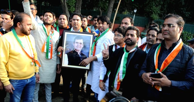 Congress workers celebrate after the party raced ahead of the BJP in the Lok Sabha constituencies of Ajmer and Alwar and the Mandalgarh Assembly seat in Rajasthan by-elections; at the ...