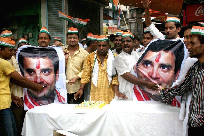 Congress workers celebrate birthday of Congress Vice President Rahul Gandhi in Varanasi on June 19, 2014.