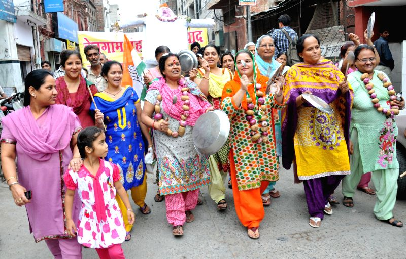 Congress workers demonstrate against hike in prices of essential commodities in Amritsar on July 2, 2014.