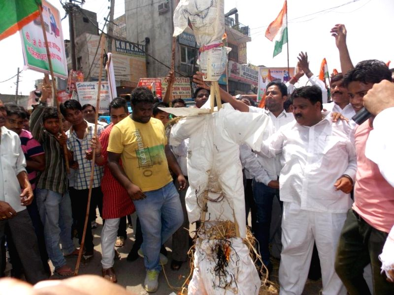 Congress workers demonstrate against hike in prices of essential commodities and water crisis in New Delhi on July 4, 2014.