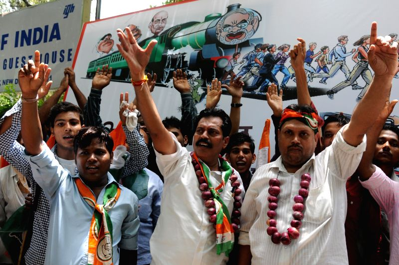 Congress workers demonstrate against hike in prices of fuel and rail tariff in New Delhi on July 7, 2014.