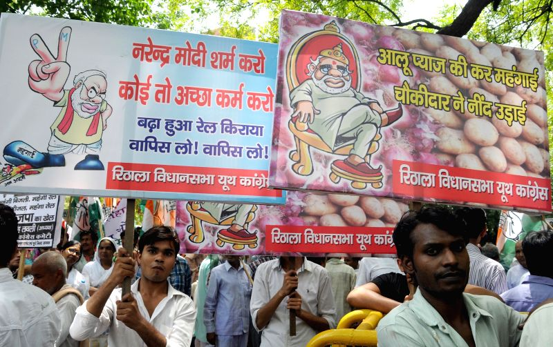Congress workers demonstrate against hike in prices of essential commodities and rail tariff in New Delhi on July 7, 2014.
