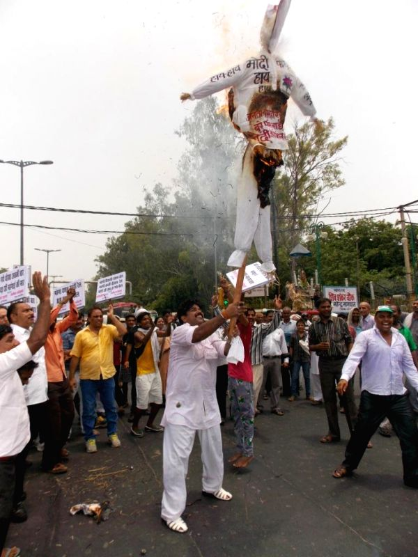Congress workers demonstrate against hike in prices of essential commodities and other issues in New Delhi on July 13, 2014.