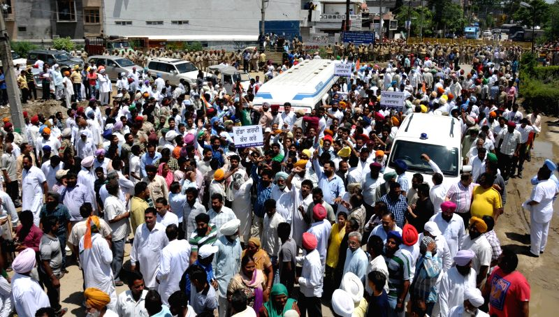 Congress workers demonstrate against Punjab local bodies Minister Anil Joshi near his residence in Amritsar on May 13, 2014.