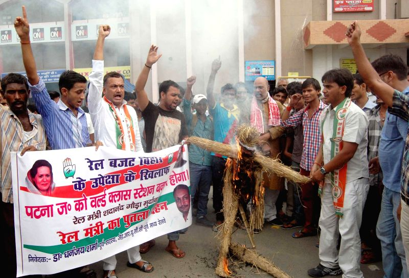 Congress workers demonstrate against Rail budget 2014-15 which was presented in the Parliament by Union Railway Minister D.V. Sadananda Gowda in Patna on July 8, 2014. - D.