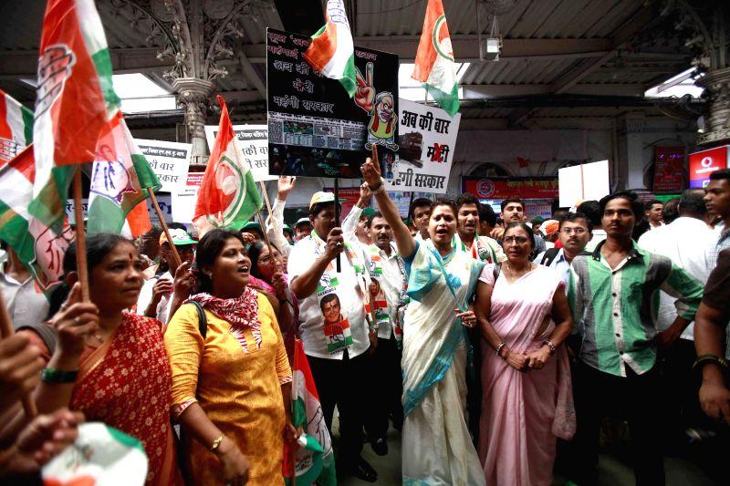 Congress workers demonstrate against rail tariff hike at the Chhatrapati Shivaji Terminus station in Mumbai on June 23, 2014.