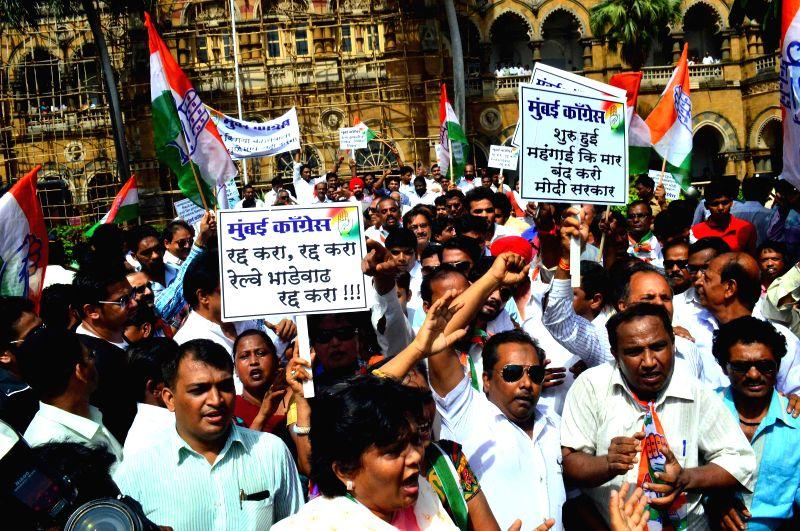 Congress workers demonstrate against rail tariff hike at the Chhatrapati Shivaji Terminus railway station in Mumbai on June 24, 2014.