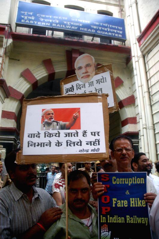 Congress workers demonstrate against rail tariff hike in Kolkata on June 30, 2014.