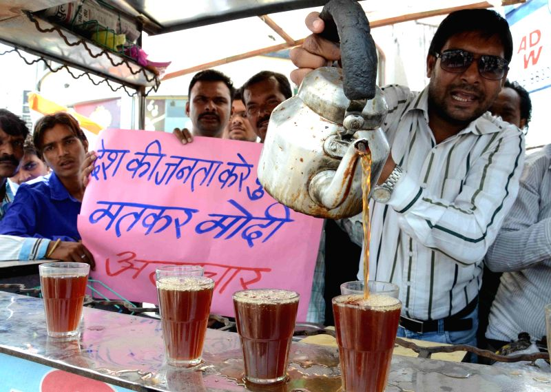 Congress workers demonstrate against rise in sugar prices by distributing sugarless tea in Bhopal on June 24, 2014.